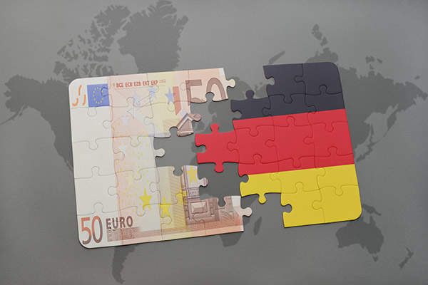 puzzle with the national flag of germany and euro banknote on a world map background. 3D illustration